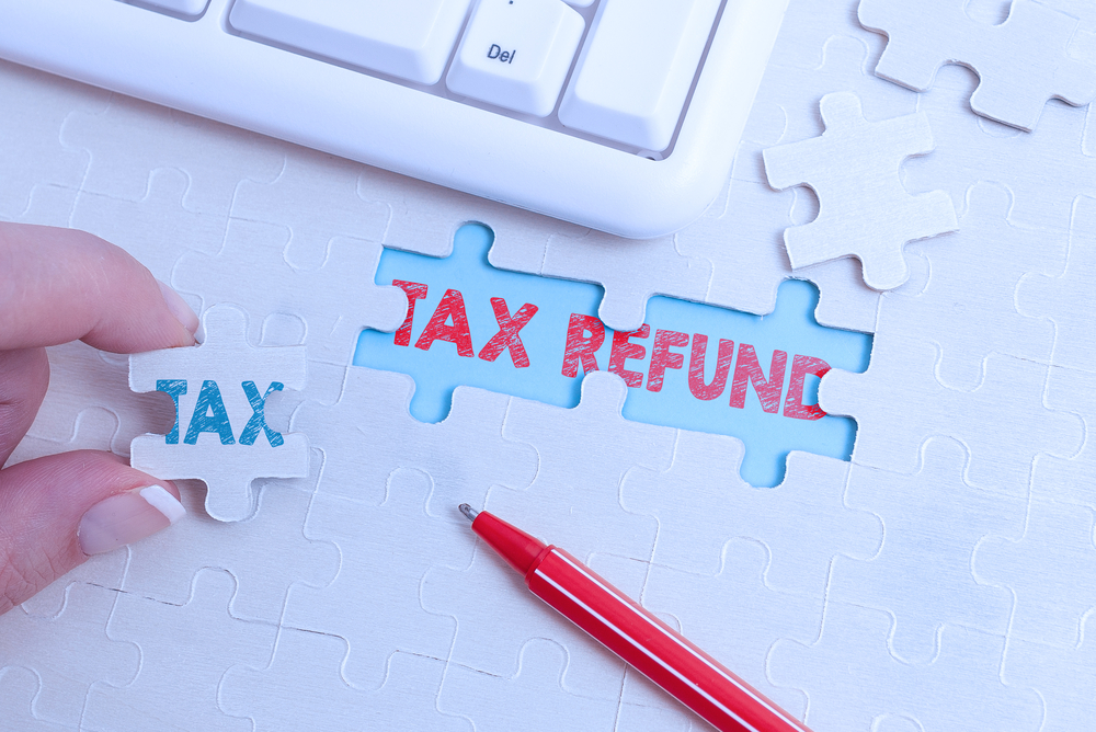 Handwriting text Tax Refund, Internet Concept excess payment of paid taxes returned to business owners Building An Unfinished White Jigsaw Pattern Puzzle With Missing Last Piece